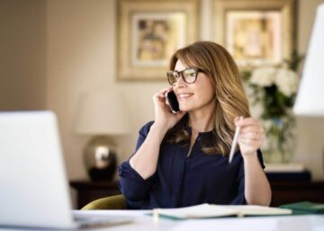 A business woman makes a phone call in a stylish home office