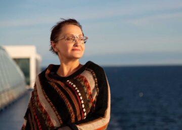A woman on a cruise enjoying retirement