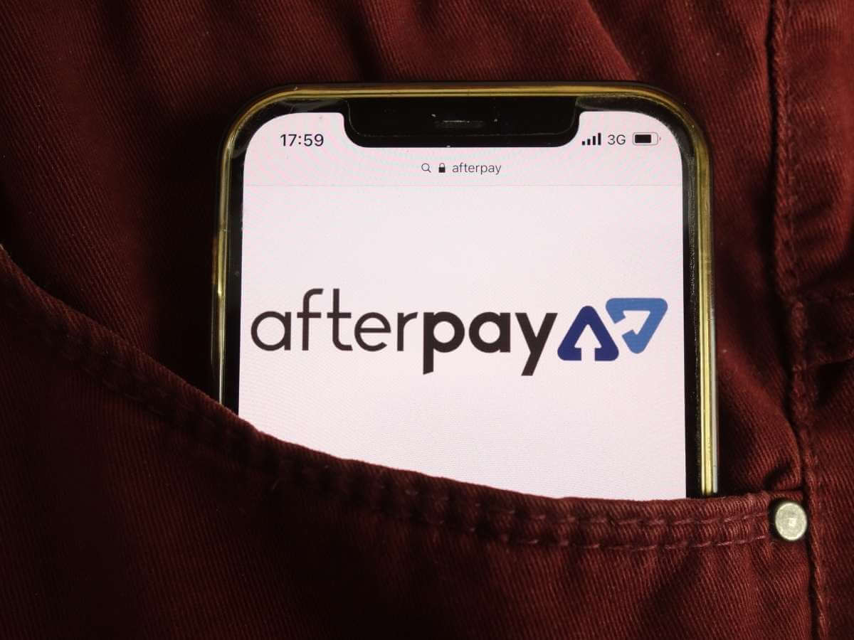 Afterpay Limited company logo on mobile phone tucked into pants pocket
