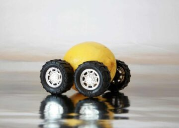 Image of a lemon with toy car wheels attached