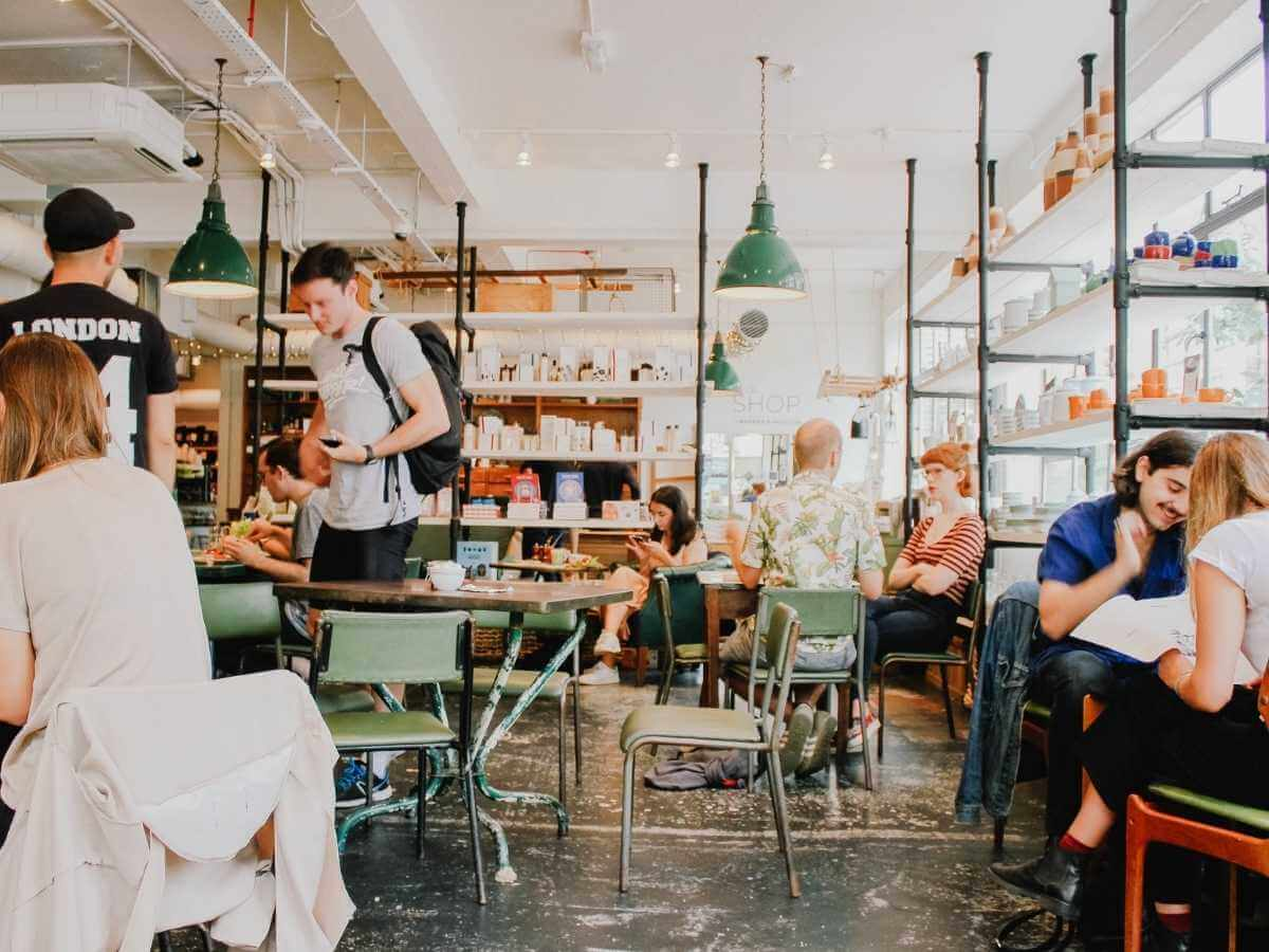 A busy cafe with seated customers